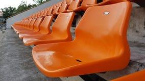 Orange Chairs in stadium. Orange Chairs in soccer stadium outdoor Royalty Free Stock Image