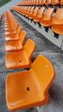 Orange Chairs in stadium. Orange Chairs in soccer stadium outdoor Royalty Free Stock Photo
