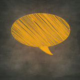 Orange chalk speech bubble in hatch, grunge background Stock Images