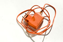 Orange charger for a mobile phone Stock Image