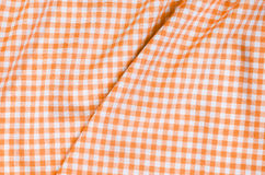 Orange checkered fabric tablecloth. Background of orange checkered fabric tablecloth Stock Photos