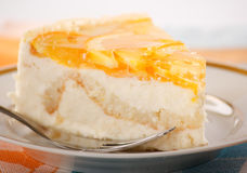 Orange cheesecake. On the plate Royalty Free Stock Photos