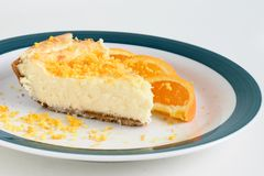 Orange Cheesecake. Dessert on a dish Stock Image