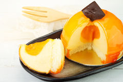 Orange cheesecake. Stuffed orange cheesecake with chocolate Royalty Free Stock Photo