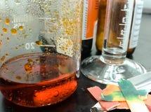 Orange chemical reaction inside a glass beaker royalty free stock photo