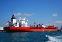 Orange Chemical tanker in Singapore anchorage. Royalty Free Stock Photography