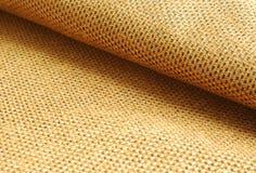 Orange Chenille fabric background. Reddish yellow Chenille fabric waved textile background Stock Photo
