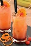 Orange cherry cocktail. Stock Photos