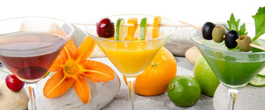 Orange, cherry and green vegetables cocktails Stock Photos
