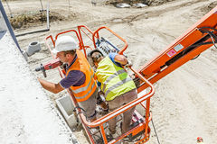 Orange cherry picker. Boom lift. Royalty Free Stock Images