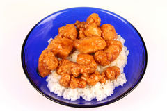 Orange Chicken. And rice in a blue bowl Royalty Free Stock Photo
