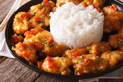Orange chicken fillet with sauce and rice closeup. horizontal Royalty Free Stock Images