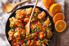 Orange chicken with green onions close-up. horizontal top view Royalty Free Stock Photography