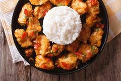 Orange chicken with rice garnish close up on a plate. Horizontal Stock Photo