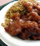 Orange Chicken. Spicy orange chicken on a bed of fried rice stock images