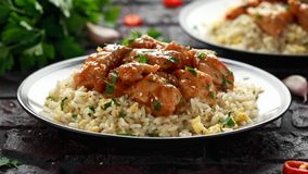 Orange Chicken Spicy sweet and sour with fried eggs rice. close up stock images