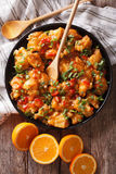 Orange chicken in sweet and sour sauce close-up. vertical top vi Stock Photos
