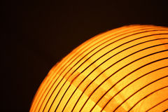 Orange Chinese paper lantern light semi abstract Stock Photos