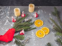 Orange chips next to the branches of spruce, wrapped with red decorative Lenka and Christmas toys royalty free stock photos