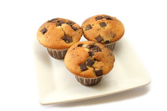 Orange and Choc Chip Muffins. Orange and chocolate flavoured muffins with choc chip pieces royalty free stock photography