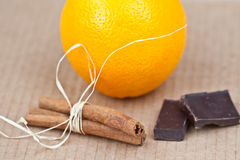 Orange with chocolate. Orange with сinnamon and chocolate Royalty Free Stock Images