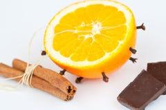 Orange with chocolate. Orange with сinnamon and chocolate Stock Photos