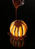 Orange in chocolate. On a black background Stock Photography