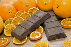 Orange chocolate. Some oranges and chocolate on wooden table Royalty Free Stock Photography