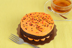 Orange chocolate cake with tea Stock Images