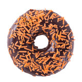 Orange chocolate donut. With sprinkles on white background top view royalty free stock image