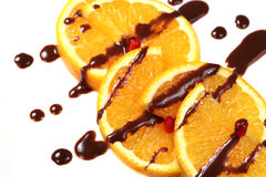Orange with  chocolate glaze Royalty Free Stock Images