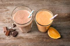Orange and chocolate milkshakes in glasses stock image