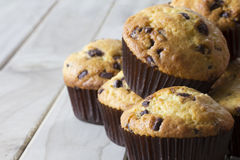 Orange and Chocolate Muffins on a Table with Copy Space Royalty Free Stock Photography