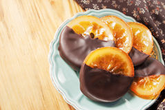 Orange with chocolate. Sliced orange with chocolate on a table Stock Images
