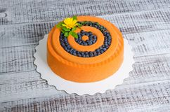 Orange chocolate velour cake with flowers, blueberries and basil Royalty Free Stock Photos