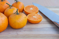 Orange on chopping block Stock Image