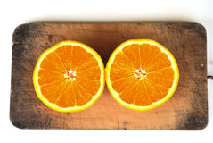 Orange  on the chopping block Royalty Free Stock Image