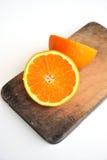 Orange  on the chopping block Royalty Free Stock Image