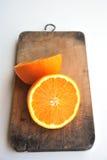 Orange  on the chopping block Royalty Free Stock Photography