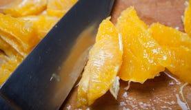 Orange chopping cook Royalty Free Stock Photo