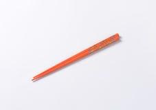 Orange chopsticks Royalty Free Stock Image