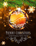 Orange Christmas ball with sparkles and fir branches. Abstract holiday background with sparkles, orange Christmas ball and fir branches Royalty Free Stock Photography