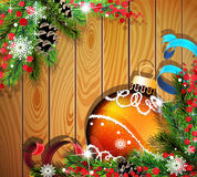 Orange Christmas ball on wooden background. Orange Christmas ball, cones, berries and fir tree branches on wooden background Stock Images