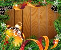 Orange Christmas ball on wooden board Stock Images