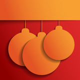 Orange Christmas balls on red. Christmas and Happy New Year background. Paper texture. Paper origami. Holiday background Royalty Free Stock Photos