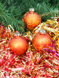Orange Christmas balls, red tinsel on Xmas tree 7 Royalty Free Stock Image