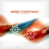 Orange Christmas blurred waves and snowflakes Stock Images