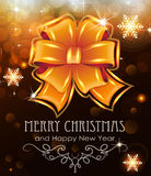 Orange Christmas bow on holiday background Royalty Free Stock Photo