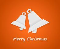 Orange christmas card. With paper christmas bells Royalty Free Stock Photography