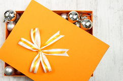 Orange Christmas gift box filled with baubles Royalty Free Stock Photo